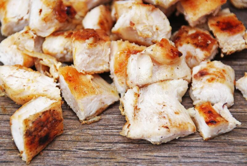 Cutted poultry meat. Chicken breast. Cutted poultry meat. Roast chicken breast, on a wooden surface stock image