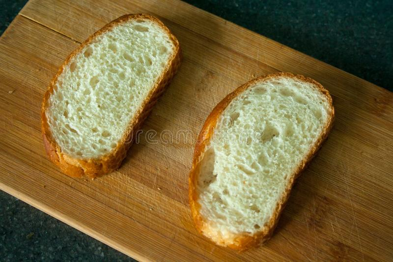 Cutted two slices of bread royalty free stock photos