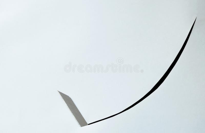 Cutter blade curve slashing on white paper background stock photography