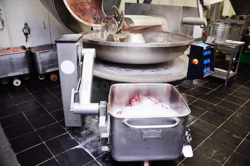 Processing of meat in the food industry on a cutter royalty free stock photography