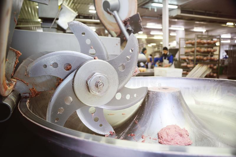 Processing of meat in the food industry on a cutter royalty free stock photos