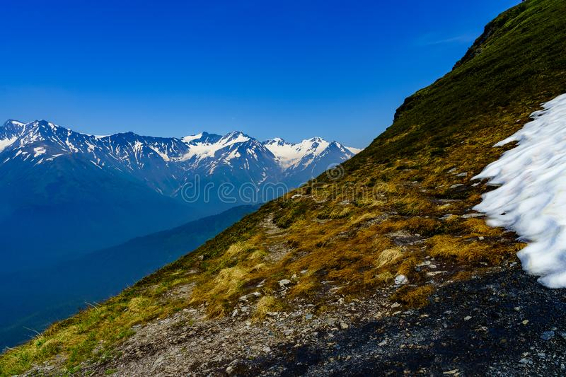 Cutting through the Alyeska Mountains in June royalty free stock photography