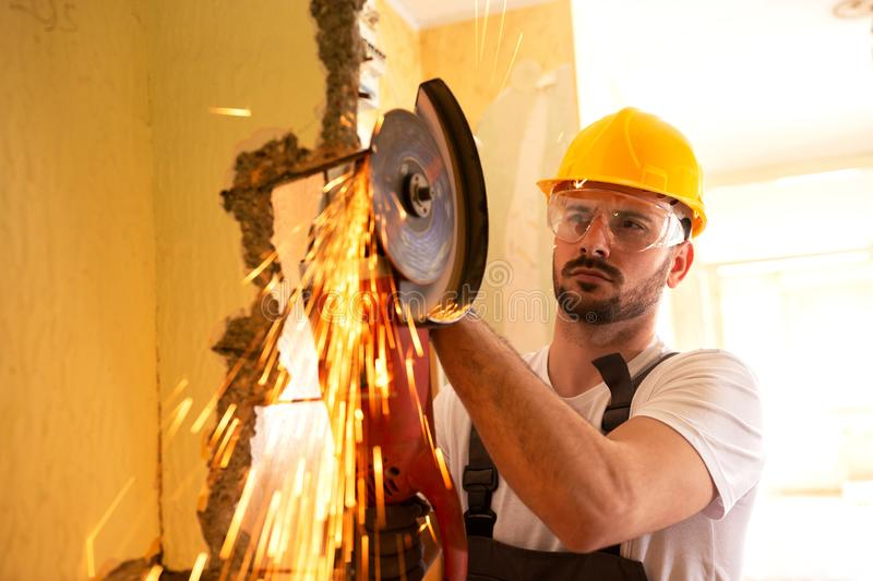 Cutting armature with electric grinder royalty free stock photography