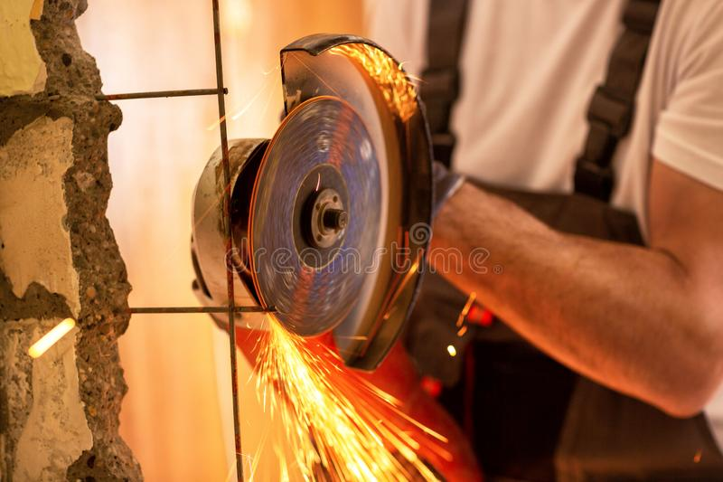 Cutting armature with electric grinder stock photo