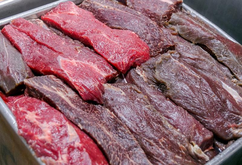Cutting beef at a meat factory stock photo