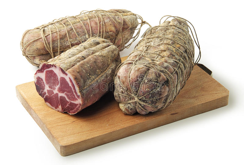 Cutting board with air-cured pork meat coppa. Cutting board with salami air-cured pork meat coppa stock photo