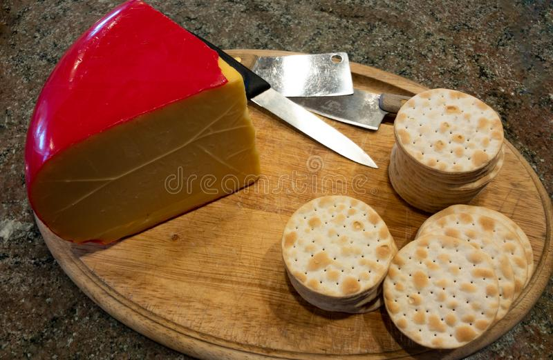 Cutting board with cheese and crackers royalty free stock photo