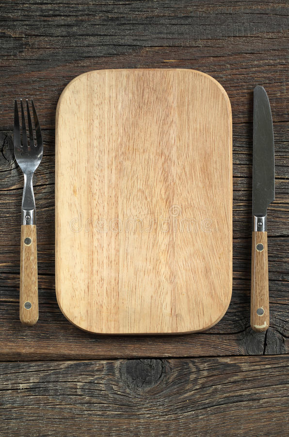 Cutting board and cutlery royalty free stock photography