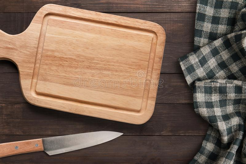 Cutting board and knife set  on wooden background. Copyspace for text and logo. Top view. stock image