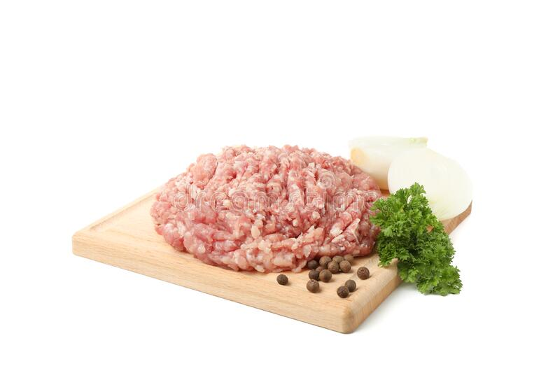 Cutting board with minced meat and spices isolated on background. Cutting board with minced meat and spices isolated on white background stock image