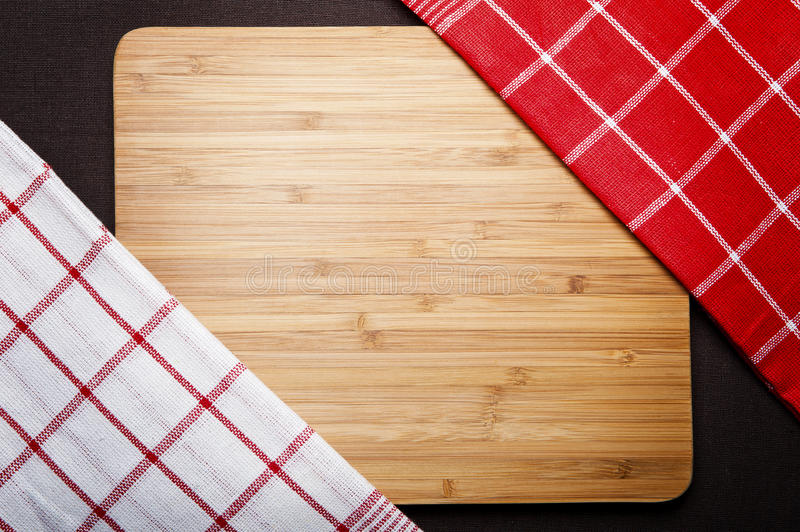 Cutting board with space for text on old wooden background,. Close-up royalty free stock photos
