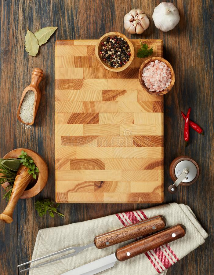 Cutting board and spices stock image