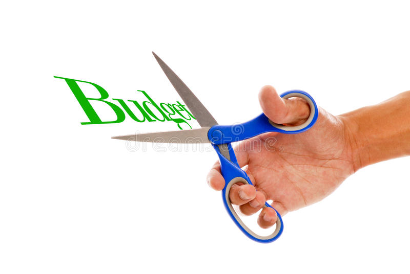 Cutting Budget. With Scissors In Male Hand royalty free stock photography