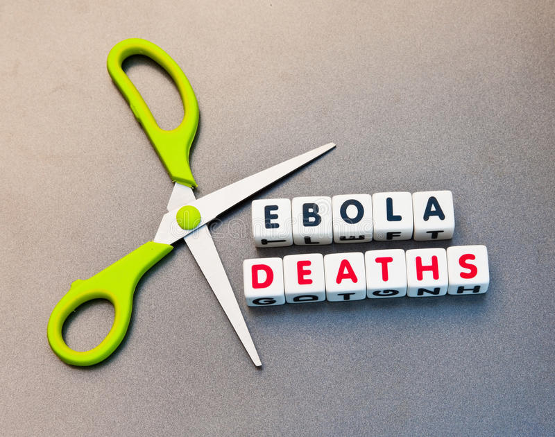 Cutting deaths from Ebola. Scissors set against text ' ebola deaths ' in uppercase letters inscribed on small white cubes, referring to the ebola virus, gray stock photos