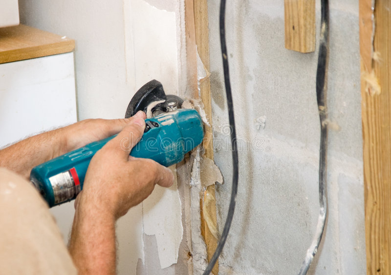 Cutting Drywall royalty free stock photo