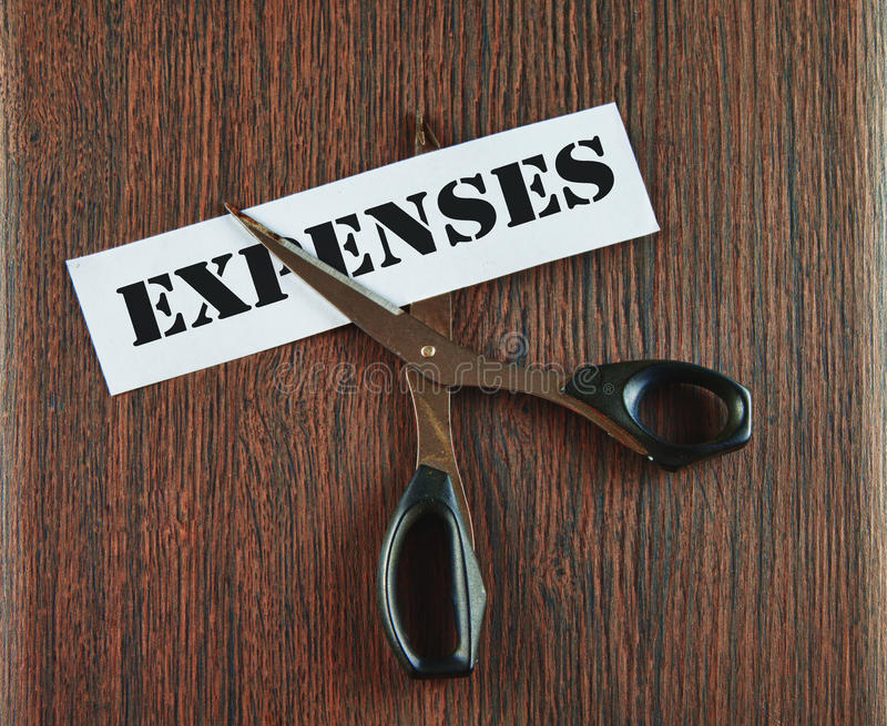 Cutting expenses stock photography