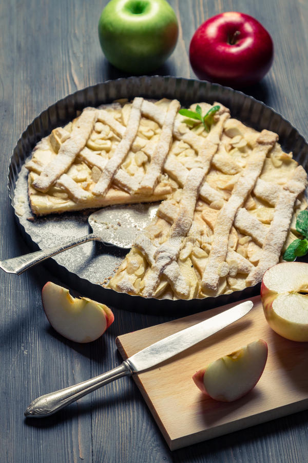 Cutting fruits and baked apple pie stock images