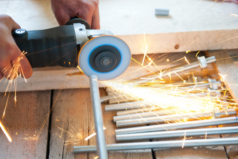 cutting grinder iron man royaltyfria foton