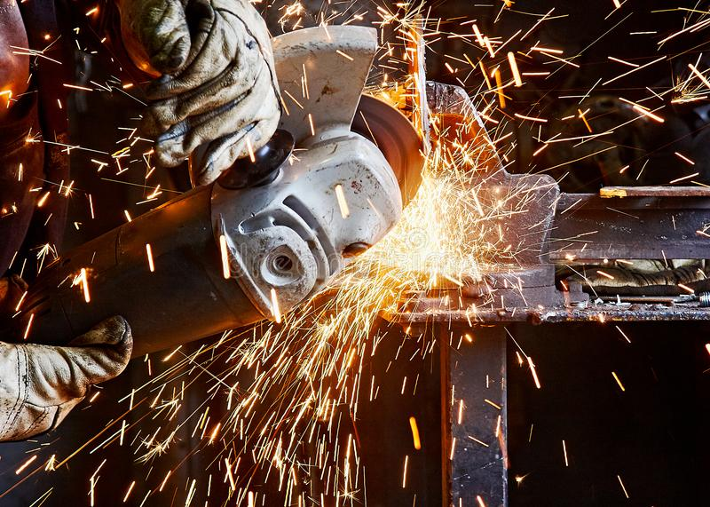 Cutting with grinder stock photo