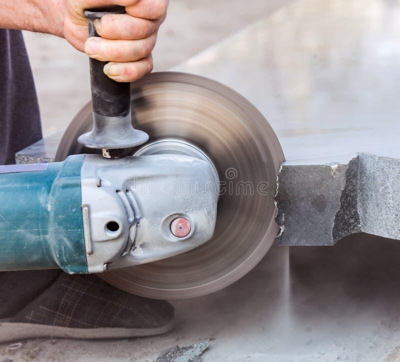 Cutting hard stone grinder stock photography