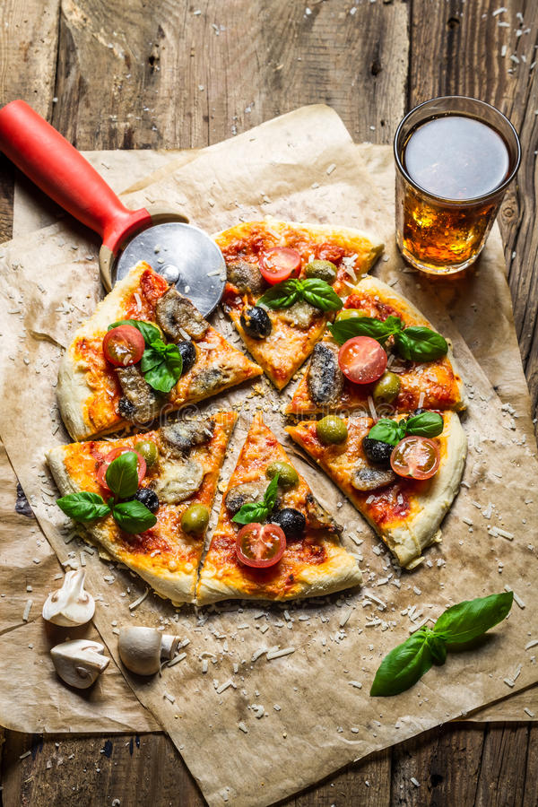 Cutting homemade pizza with mushrooms stock photos