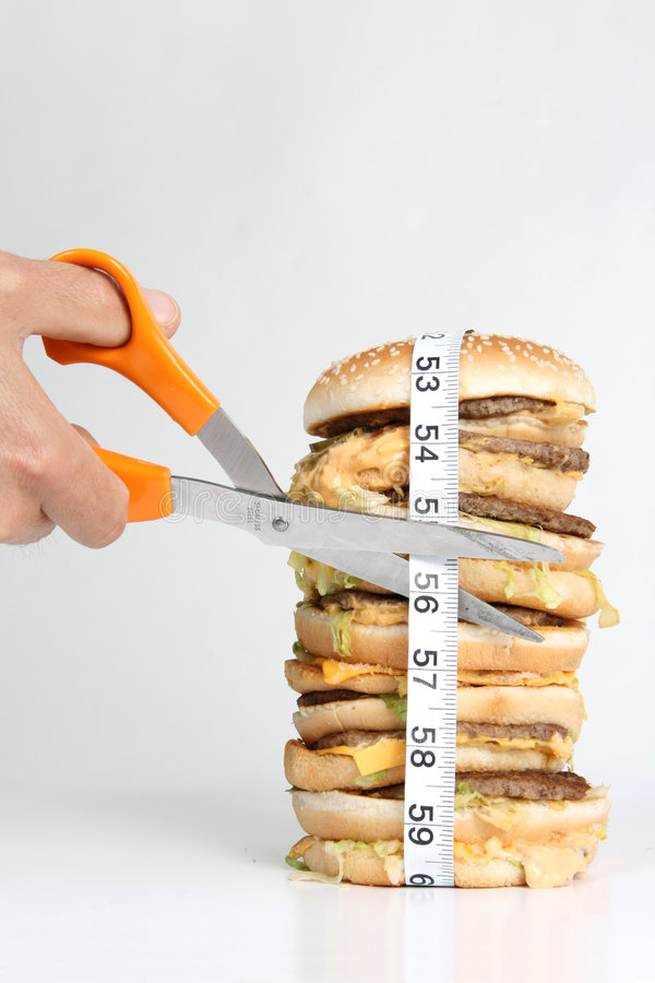 Cutting the inches royalty free stock photo