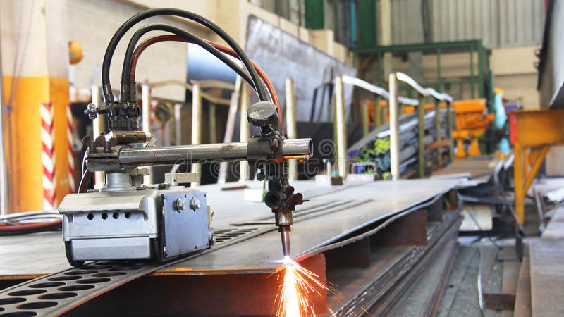 Cutting machine for steel sheet. This is rail of steel cutting tools in the industry stock photos