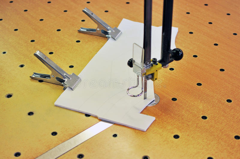 Cutting. Manufacture of wearing apparel-cutting elements stock photography