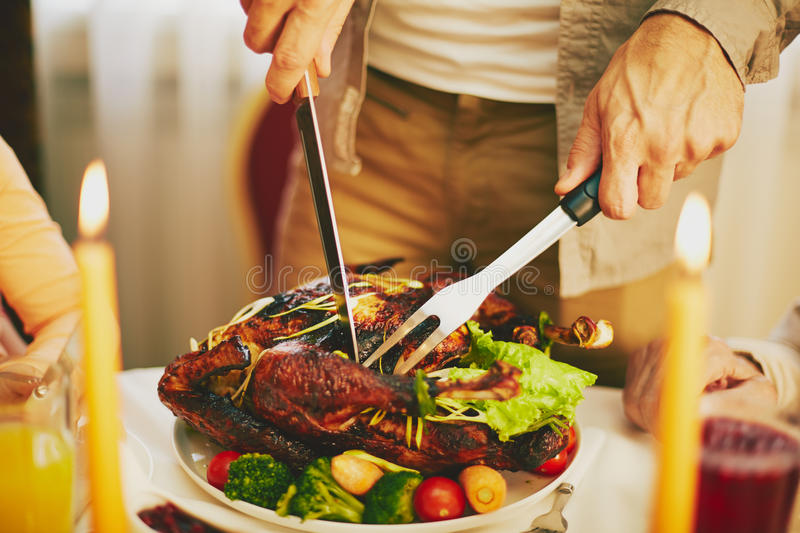 Cutting meat royalty free stock photos