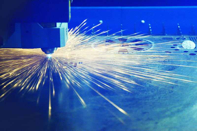 Cutting metal with a laser royalty free stock images
