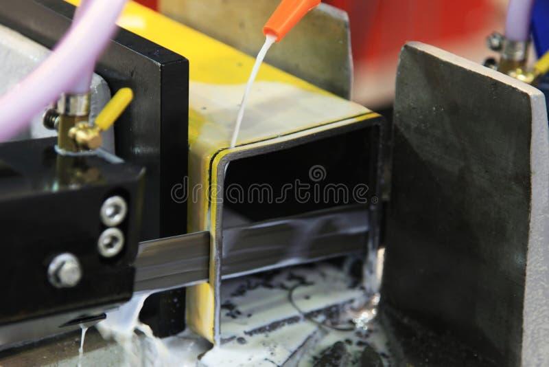 Cutting metal mechanical saw stock photography