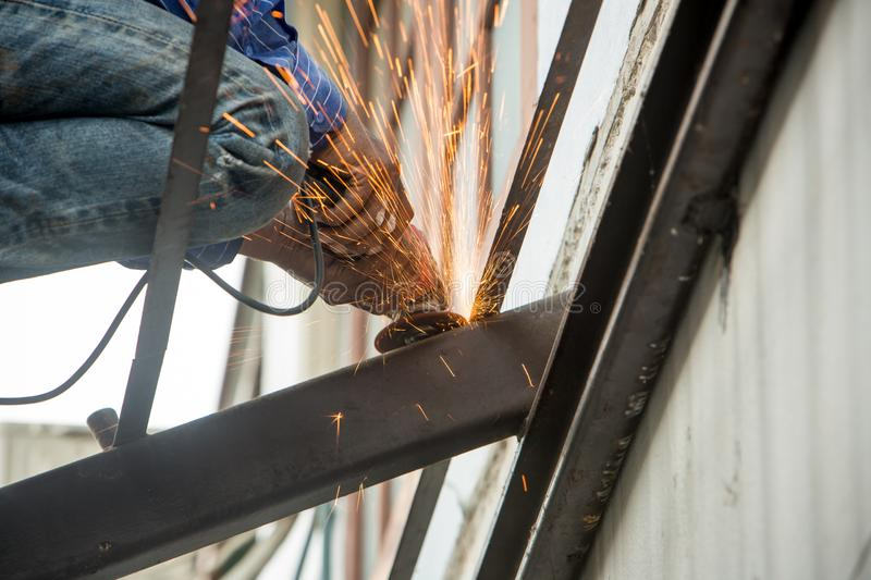 Cutting metal reinforcement rebar rods at building site stock photography