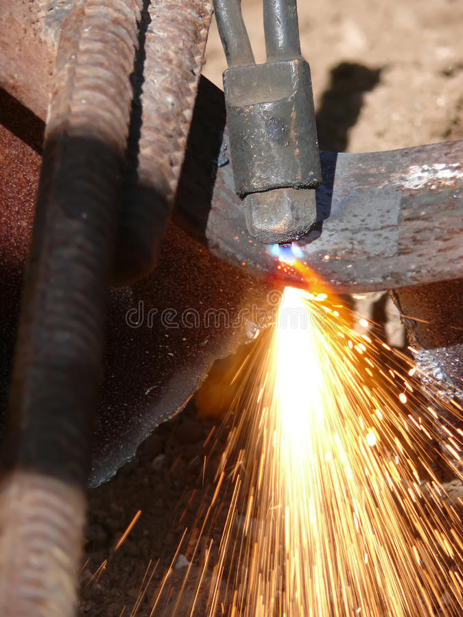 Cutting metal tool torch. Sparks and flashes in the course of cutting of metal by a gas torch stock image