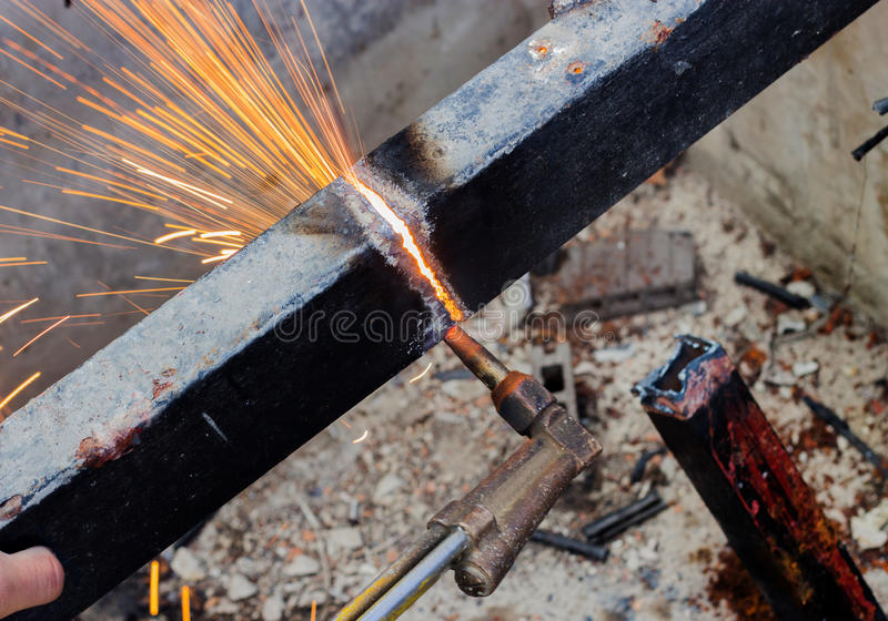 Cutting old steel with fire stock images