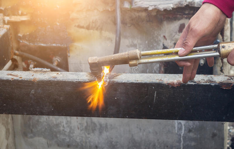 Cutting old steel with fire stock photography