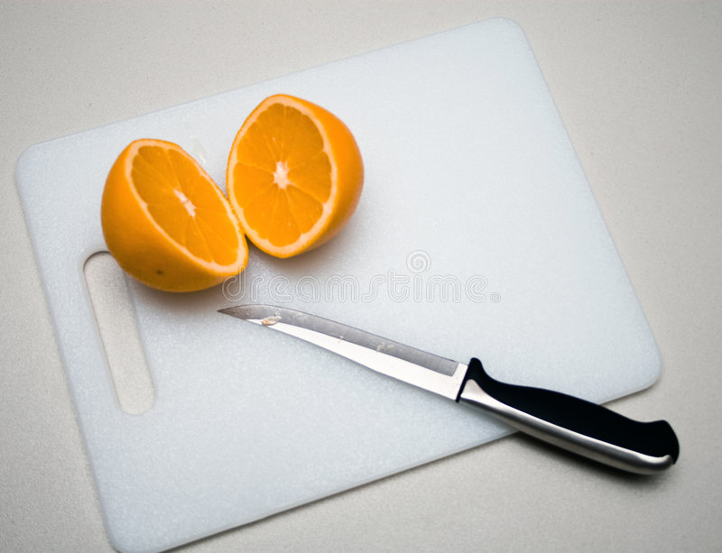 Download Cutting an Orange stock image. Image of lying, sliced - 7517141