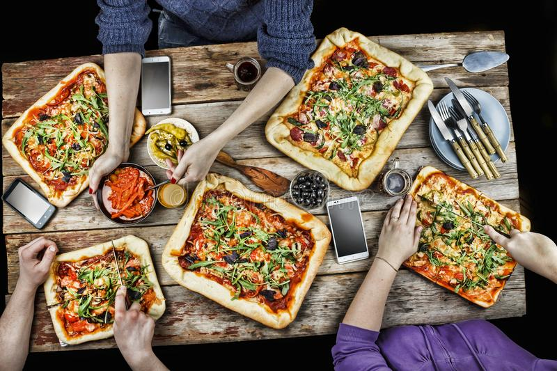 Cutting pizza. Domestic food and homemade pizza. royalty free stock images