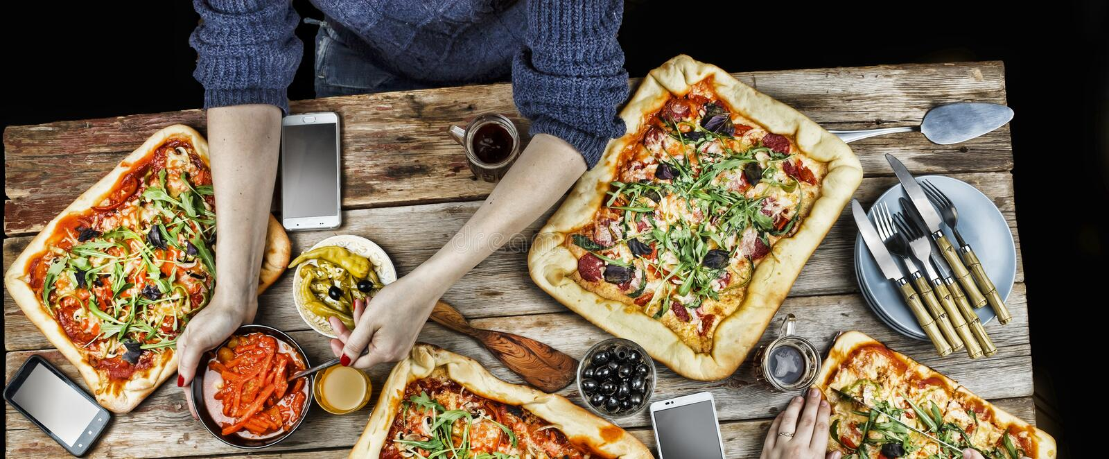 Cutting pizza. Domestic food and homemade pizza. royalty free stock photography