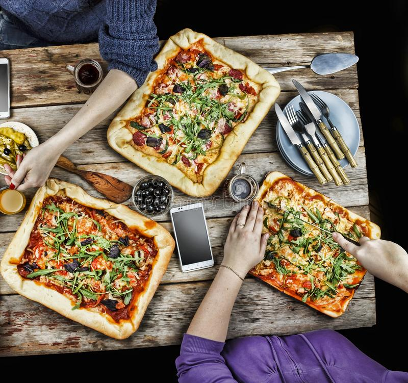Cutting pizza. Domestic food and homemade pizza. royalty free stock image
