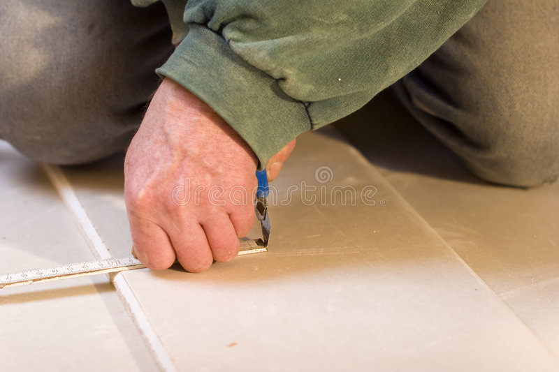 Cutting plasterboards stock photography