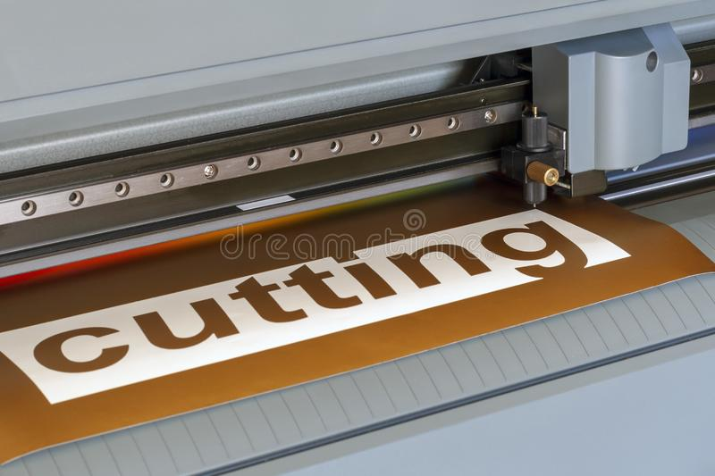Cutting plotter close-up. The process of cutting a vinyl film.  stock photo