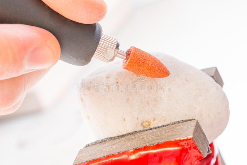 Cutting and polishing stone with rotary multi tool. Using a high speed rotary multi tool to cutting and polishing on the stone stock photography