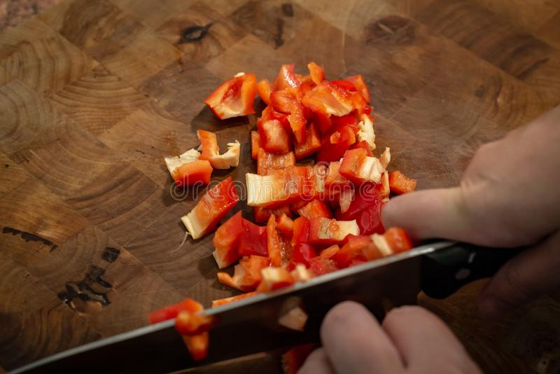 Cutting red pepper on the table stock image