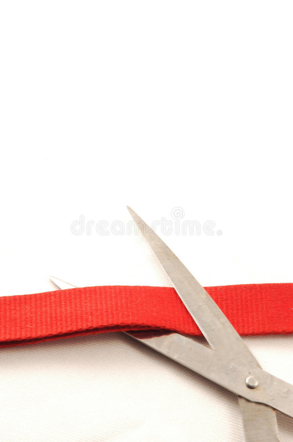 Cutting red ribbon royalty free stock photo
