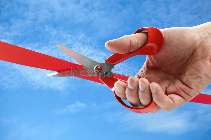 Cutting a red ribbon royalty free stock images