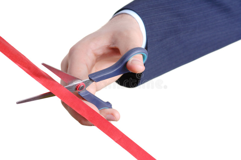 Cutting a red tape stock images