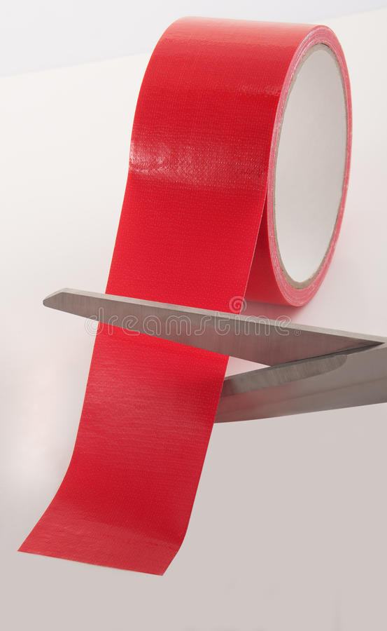 Cutting Red Tape. Symbol of cutting red tape of legal matters royalty free stock images
