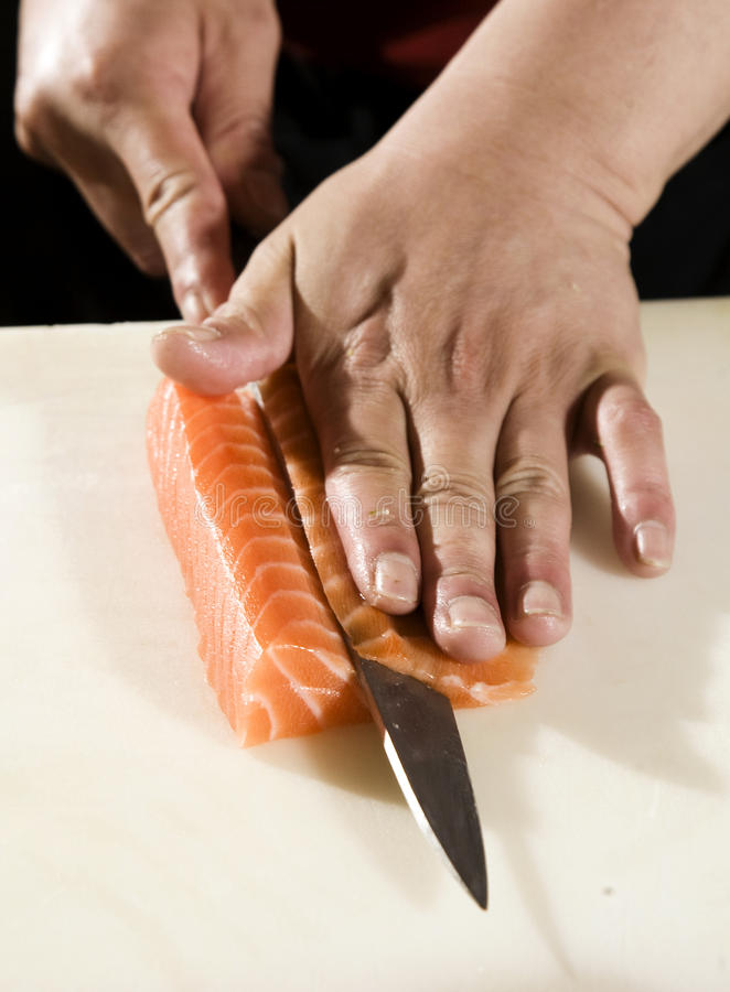 Cutting Salmon stock images