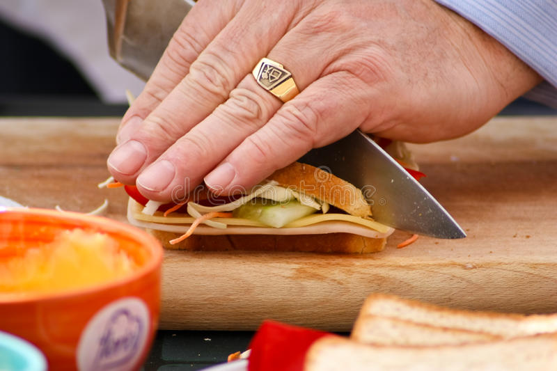 Download Cutting a sandwich stock image. Image of making, sandwich - 14258957