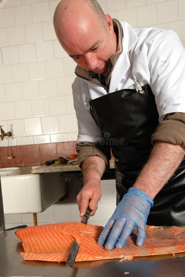 Cutting smoked salmon royalty free stock photos
